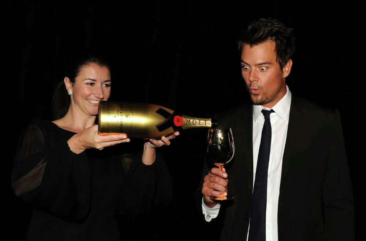 BEVERLY HILLS, CA - DECEMBER 14: (L-R) Moet & Chandon's Julia Fitzroy and actor Josh Duhamel during the 68th Annual Golden Globe Awards nomination announcement held at the Beverly Hilton Hotel on December 14, 2010 in Beverly Hills, California. (Photo by Kevin Winter/Getty Images) *** Local Caption *** Julia Fitzroy;Josh Duhamel