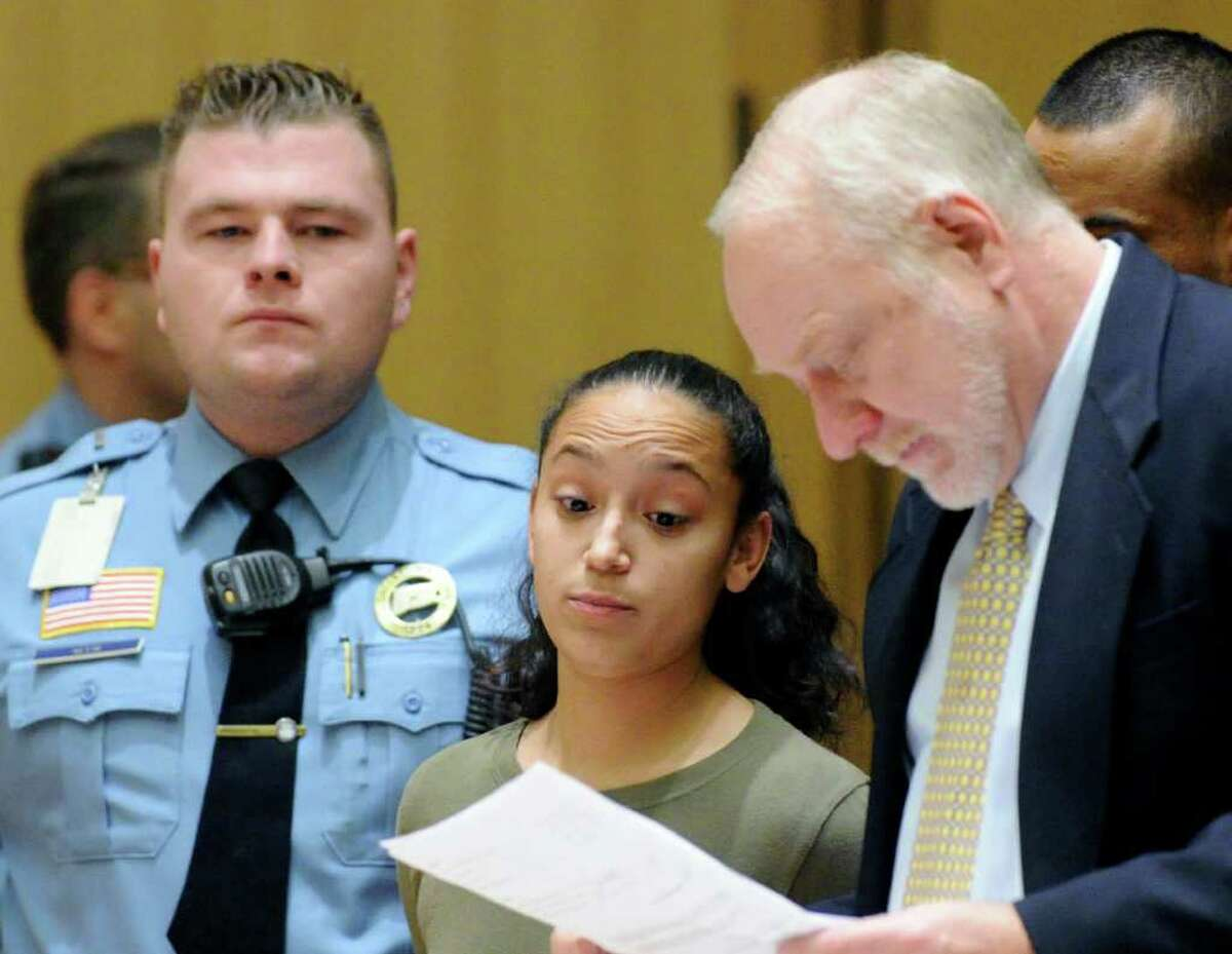 Yvania Collazzo, center, appears in State Superior Court, Stamford, Tuesday afternoon, Dec. 14, 2010, during arraignment on the charge of hindering prosecution in shooting and murder of Denny Alcantara, Nov. 4, 2009, in Stamford. At right is attorney Howard Ehring.