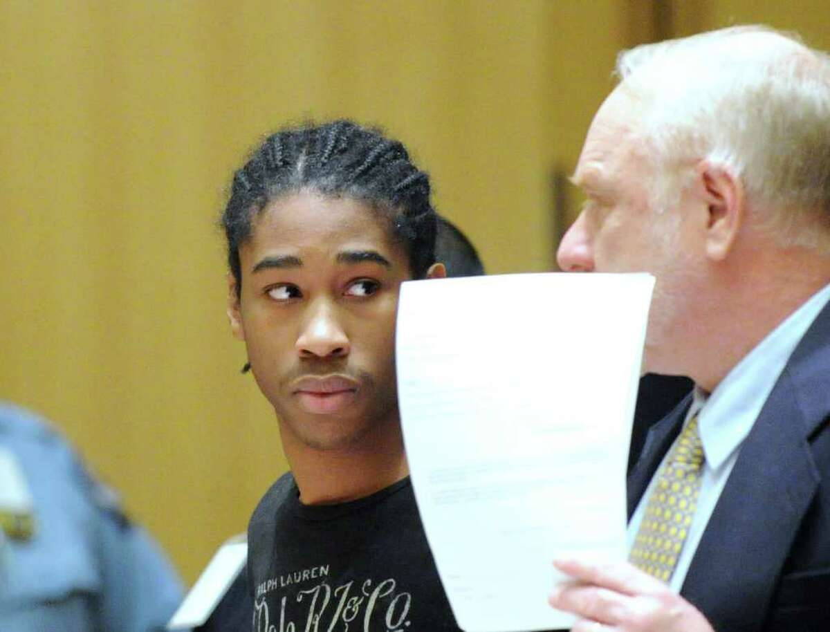 Joshua McNeil, center, appears in State Superior Court, Stamford, Tuesday afternoon, Dec. 14, 2010, during arraignment on the charge of murder in the shooting of Denny Alcantara, Nov. 4, 2009, in Stamford. At right is attorney Howard Ehring.