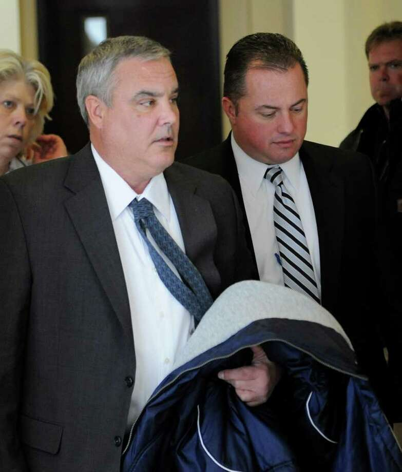Jim Bailey, left, and Albany Police Detective Commander Anthony Ryan walk down the hallway to Judge Dan Lamont's courtroom in the Albany County Judicial Center  on Tuesday, Dec. 14, 2010 to wait for a verdict in the trial of the man acccused of killing Bailey's son, Richard. (Skip Dickstein / Times Union) Photo: SKIP DICKSTEIN / 2008