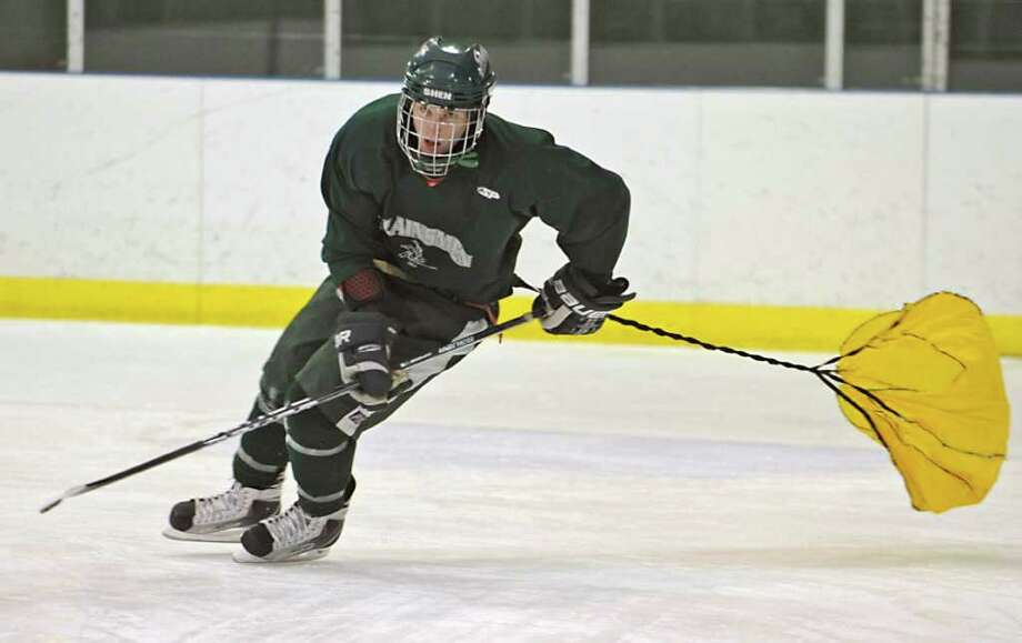 High school hockey -- Shenendehowa hockey player Michael Mcarthy runs through a drill with a parachute attached to him during pratice in Clifton Park on Monday, Dec. 6. (Lori Van Buren / Times Union) Photo: Lori Van Buren