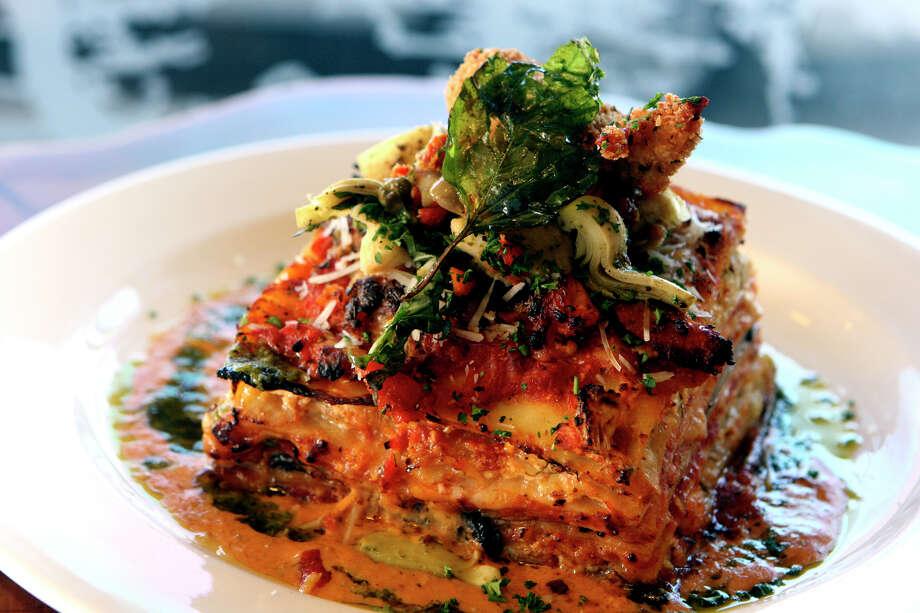Cypress Grille of Boerne creates its Lobster Brie Portobello Lasagna dish. HELEN L. MONTOYA / EXPRESS-NEWS