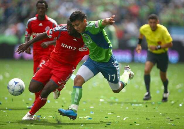 Seattle Sounders player Fredy Montero drives toward the goal against Toronto player --- in the first half on Saturday August 29, 2009 at Qwest Field in Seattle. (Photo/Seattlepi.com, Joshua Trujillo) Photo: Joshua Trujillo/seattlepi.com