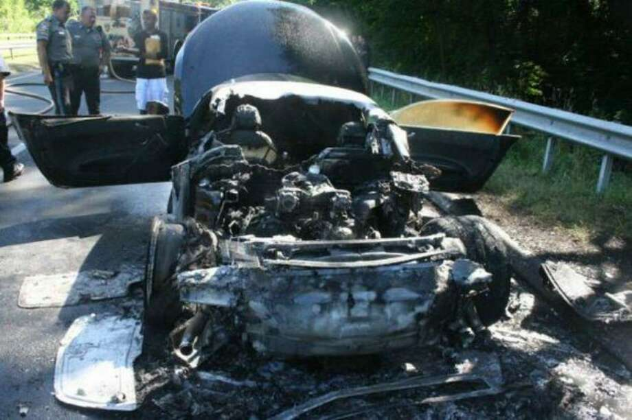 Fire officials are investigating the cause of an early morning car fire on the Merritt Parkway that destroyed an Audi R8 belonging to a Connecticut Powerball winner. Photo: Scott R. Bisson For The Connecticut Post