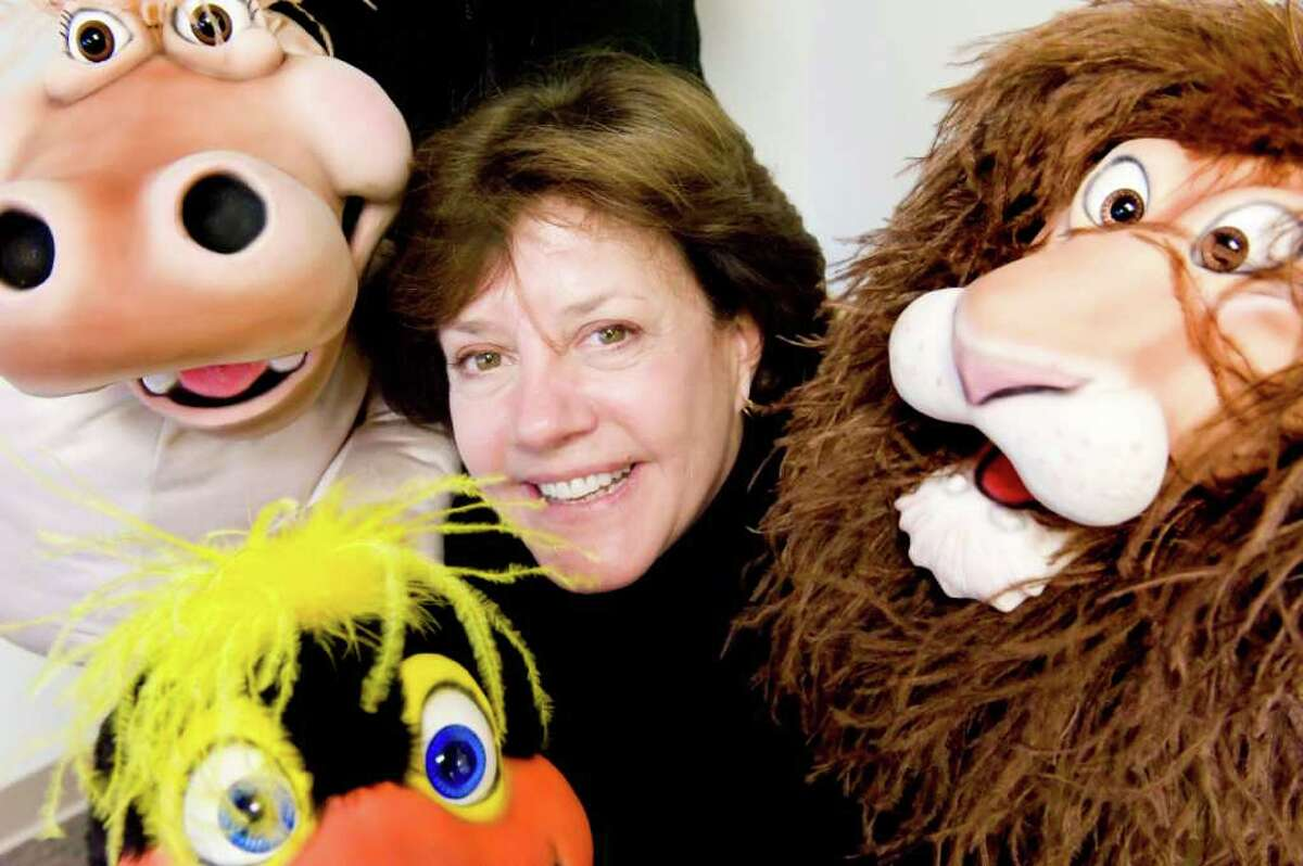 Educator Dona McKenzie of PeaceWorks, an arm of the Domestic Violence Crisis Center, at the center's offices on Summer Street in Stamford, Conn., Monday, December 6, 2010. The puppets are used to educate children about domestic violence and anger management.