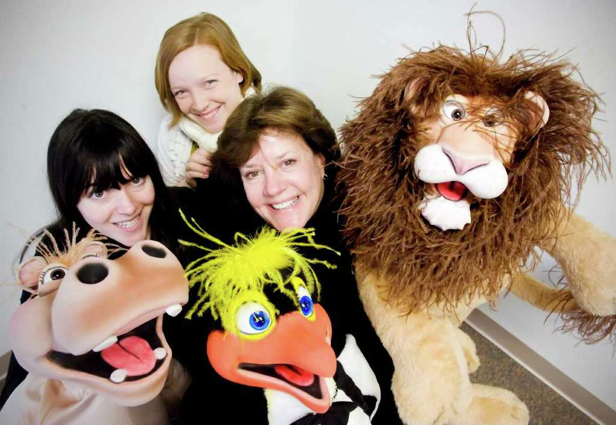 Educators Caitlin McArdle, left, Lauren Linkowski and Dona McKenzie of PeaceWorks, an arm of the Domestic Violence Crisis Center, at the center's offices on Summer Street in Stamford, Conn., Monday, December 6, 2010. The puppets are used to educate children about domestic violence and anger management.