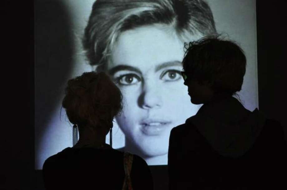 An Andy and an Edie watch an Edie Sedgwick video at the SAM Remix Andy Warhol event Saturday. (Kelly Hendrickson/UW News Lab) Photo: /