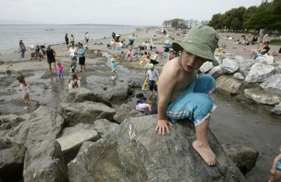 A child climbs the rocks next to the creek at Golden Gardens Park in this May 2008 file photo. Photo: / P-I File