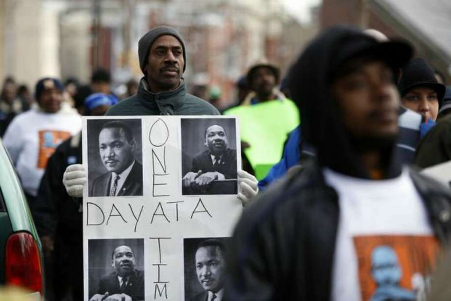 Tyrone Austin marches along with others to take part in the Greater Philadelphia Martin Luther King Day of Service, at Girard College in Philadelphia on Monday. (AP Photo/Matt Rourke) Photo: / Associated Press