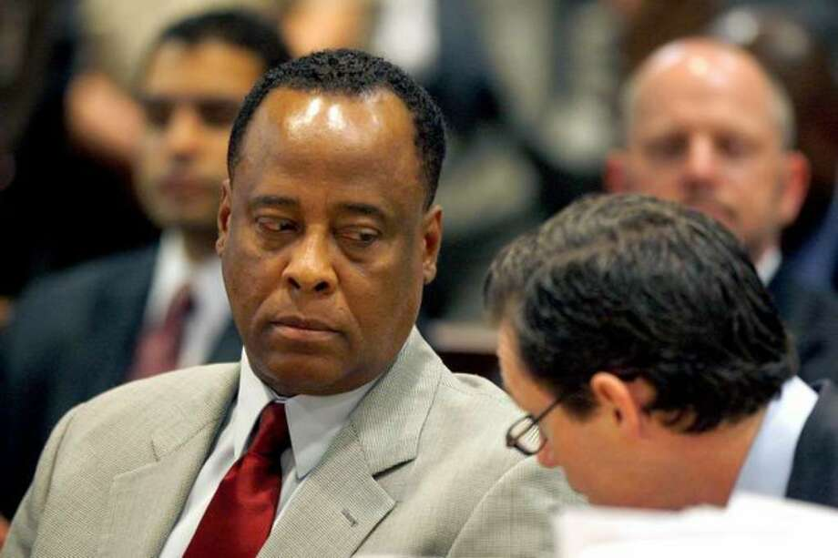 Dr. Conrad Murray (left) and defense attorney Ed Chernoff confer as Murray is arraigned in the County of Los Angeles Airport Branch Courthouse on a charge of involuntary manslaughter in connection with the death of pop star Michael Jackson on Monday, Feb. 8, 2010. Murray was personal physician to Michael Jackson when he died from an overdose of a powerful prescription sedative at the age of 50 on June 25, 2009. Jackson was rehearsing for a 50-concert comeback series at the O2 arena in London while staying at a rented estate in the Holmby Hills area of Los Angeles. He was pronounced dead at nearby Ronald Reagan UCLA Medical Center. (Photo by Mark Boster-Pool/Getty Images) Photo: / Getty Images