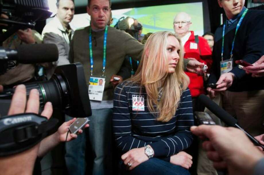US alpine skier Lindsey Vonn is surrounded by media during a news conference in advance of the 2010 Winter Olympic Games on Wednesday, Feb. 10, 2010, in Vancouver. Vonn revealed that she sustained a shin injury in training that puts her participation in the games in question. ( Smiley N. Pool / Houston Chronicle ) Photo: /