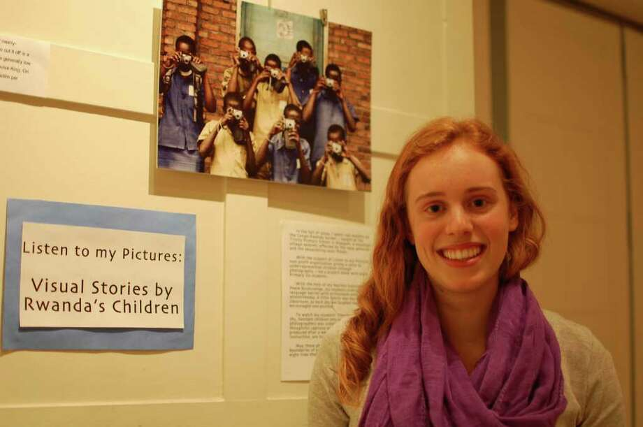 """After graduating from Convent of the Sacred Heart in 2009, Greenwich native Cailey Cron, shown Tuesday at the school, traveled to Rwanda and taught photography to children there. An exhibition called """"Listen to My Pictures: Visual Stories by Rwanda's Children,"""" includes photographs the children took, and will be on display at the school through Jan. 28. (Photo by Lisa Chamoff/staff) Photo: Contributed Photo / Greenwich Time Contributed"""