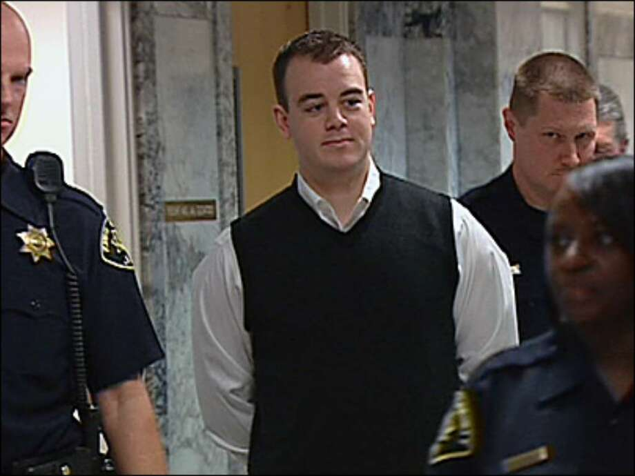 Conner Schierman is escorted into a King County Superior Court courtroom on Monday. Photo: KOMONews.com