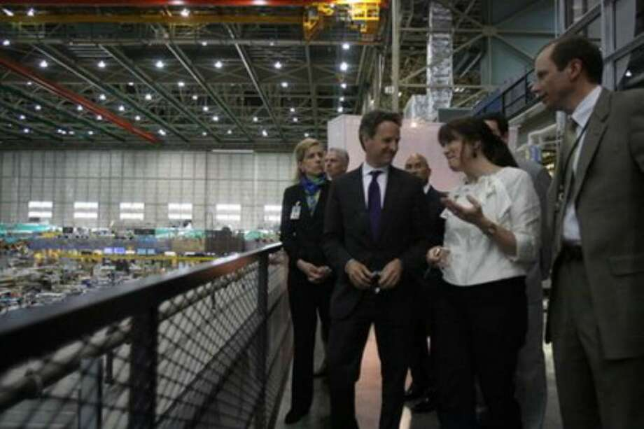 Treasury Secretary Tim Geithner, left, talks with Beverly Wyse, vice president and general manager, 737 program, Boeing Commercial Airplanes, and other Boeing executives during a tour of Boeing's 737 assembly line on Tuesday, May 18, 2010, in Renton, Wash. (Aubrey Cohen/seattlepi.com) Photo: Aubrey Cohen/seattlepi.com
