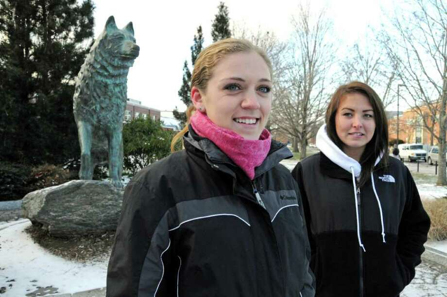 Junior at UCONN, Kelly Davis, left, from Walpole, MA, and freshman Brielle Trujillo, right, from Nutley, New Jersey, on the Storrs, Connecticut campus on December, 14, 2010. Photo: George Ruhe / Connecticut Post Freelance