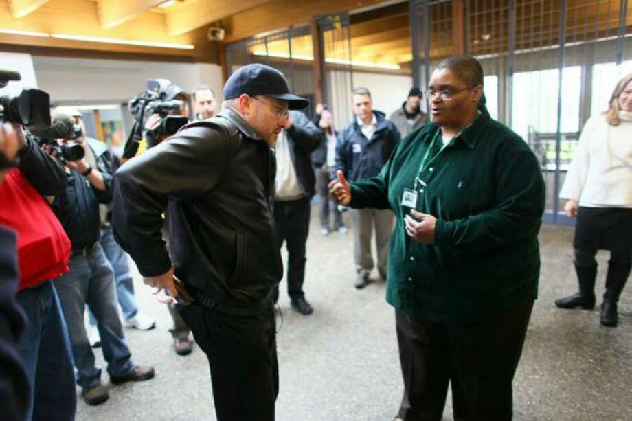 Seattle Parks Department employee Lisa Harrison, right, asks Robert Warden to leave the Southwest Community Center on Nov. 14, 2009, because the Kent man was carrying a concealed handgun. Warden walked into the building armed to begin his legal challenge to the City of Seattle's ban on firearms on city-owned property. Photo: Joshua Trujillo/seattlepi.com