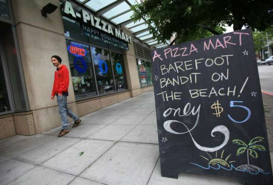 "A-Pizza Mart offers a ""Barefoot Bandit"" cocktail as a hearing for Colton Harris-Moore takes place down the street at the United States Courthouse in Seattle. Photo: Joshua Trujillo/seattlepi.com"