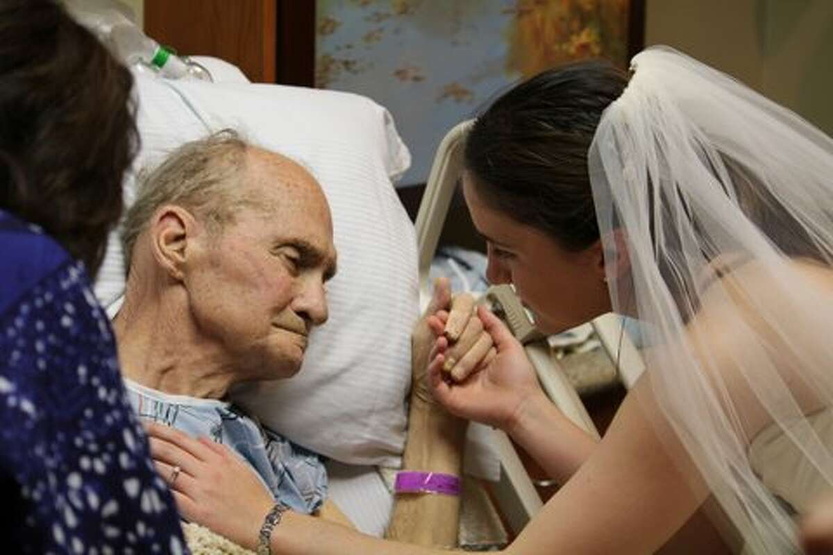 """Bride-to-be Chrysalis Autry, 26, talks to her father, Jack Autry, 65, about her wedding dress. """"Do I look like your little princess?"""" she asked him during the 20 seconds he was alert enough to see her in the gown she will get married in next year. Her father died three days later. He was diagnosed with melanoma in September."""