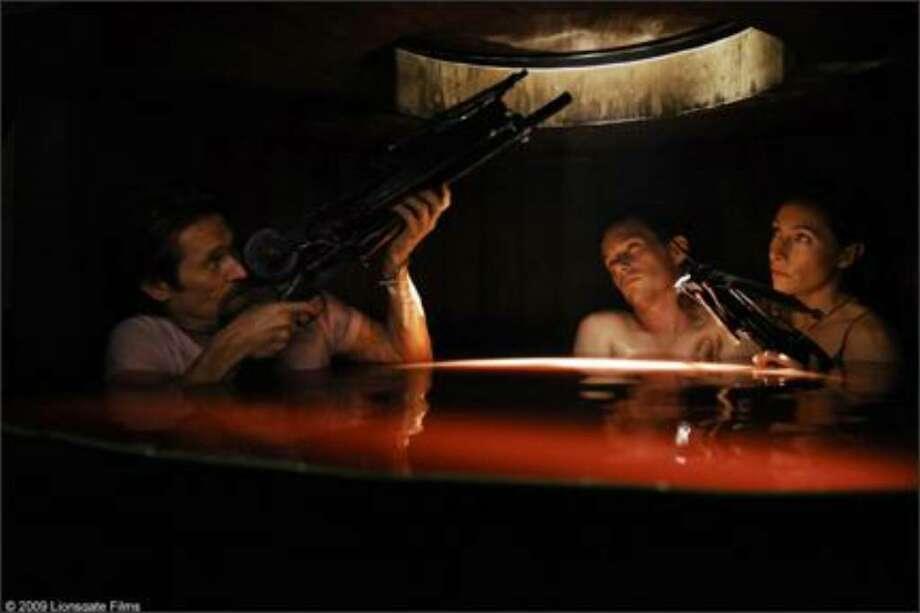 "Willem Dafoe as Lionel ""Elvis"" Cormac, Ethan Hawke as Edward Dalton and Claudia Karvan as Audrey Bennett in ""Daybreakers."""
