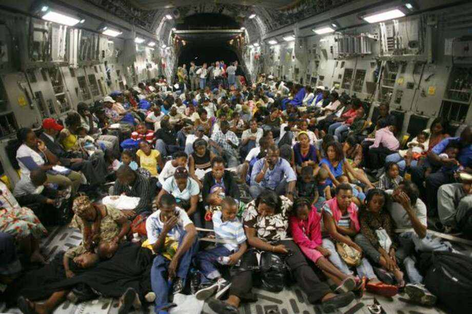 Almost 200 evacuees crowd into a C-17 Globemaster at the Port-Au-Prince airport on Sunday. See more photos from the mission. Photo: Joshua Trujillo/seattlepi.com