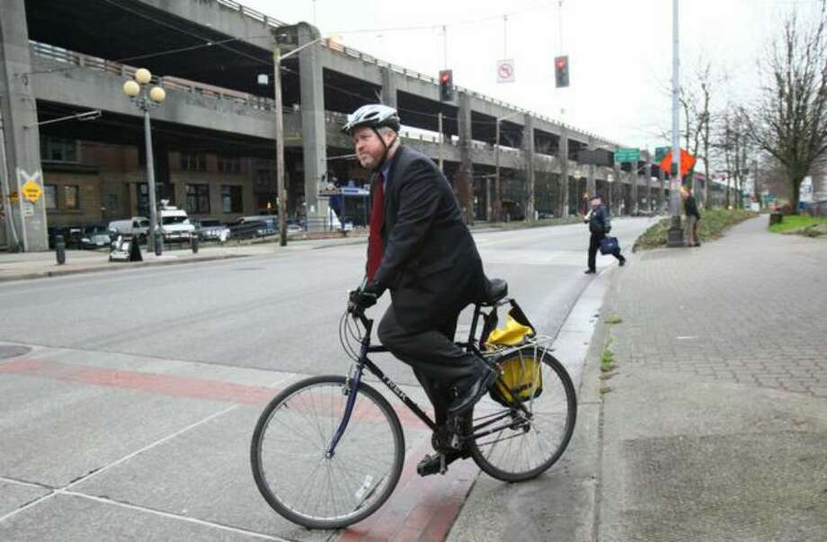 Mayor Mike McGinn bikes away from a news conference in front of the Alaskan Way Viaduct in January. Photo: Joshua Trujillo/seattlepi.com