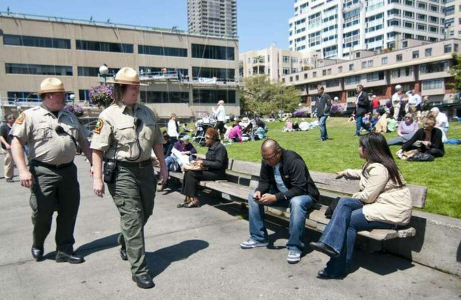 Park rangers Corby Christensen, left, and Sandra Wilcox make their rounds through Victor Steinbrueck Park near Pike Place Market on Monday July 19, 2010. Photo: Sang Cho/seattlepi.com