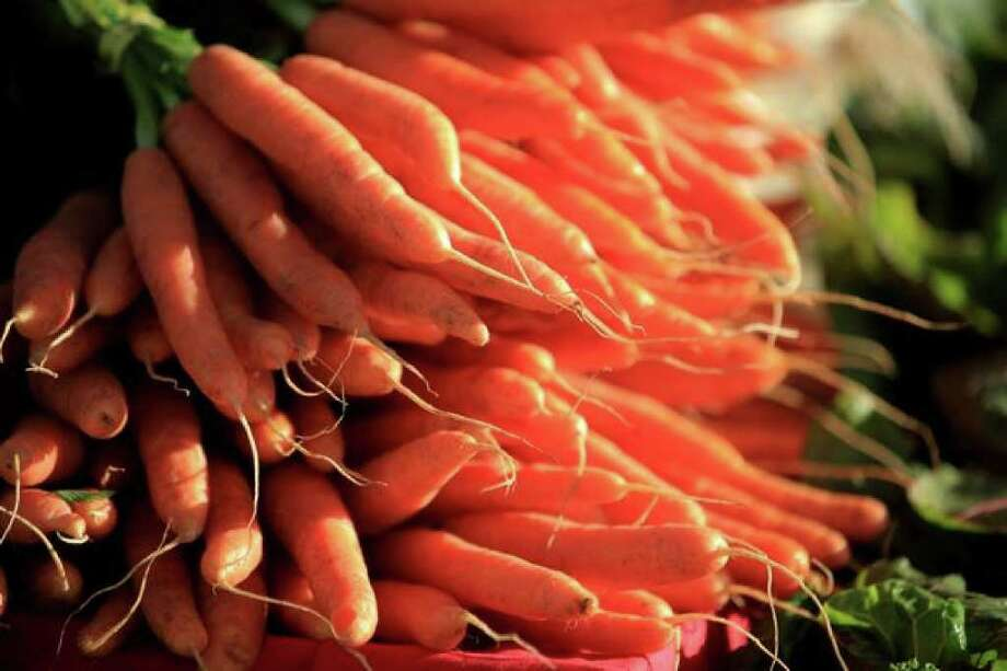 Carrots from Colinwood Farm in Port Townsend are shown during the Olympic Sculpture Park Farmers Market. Photo: Joshua Trujillo/seattlepi.com