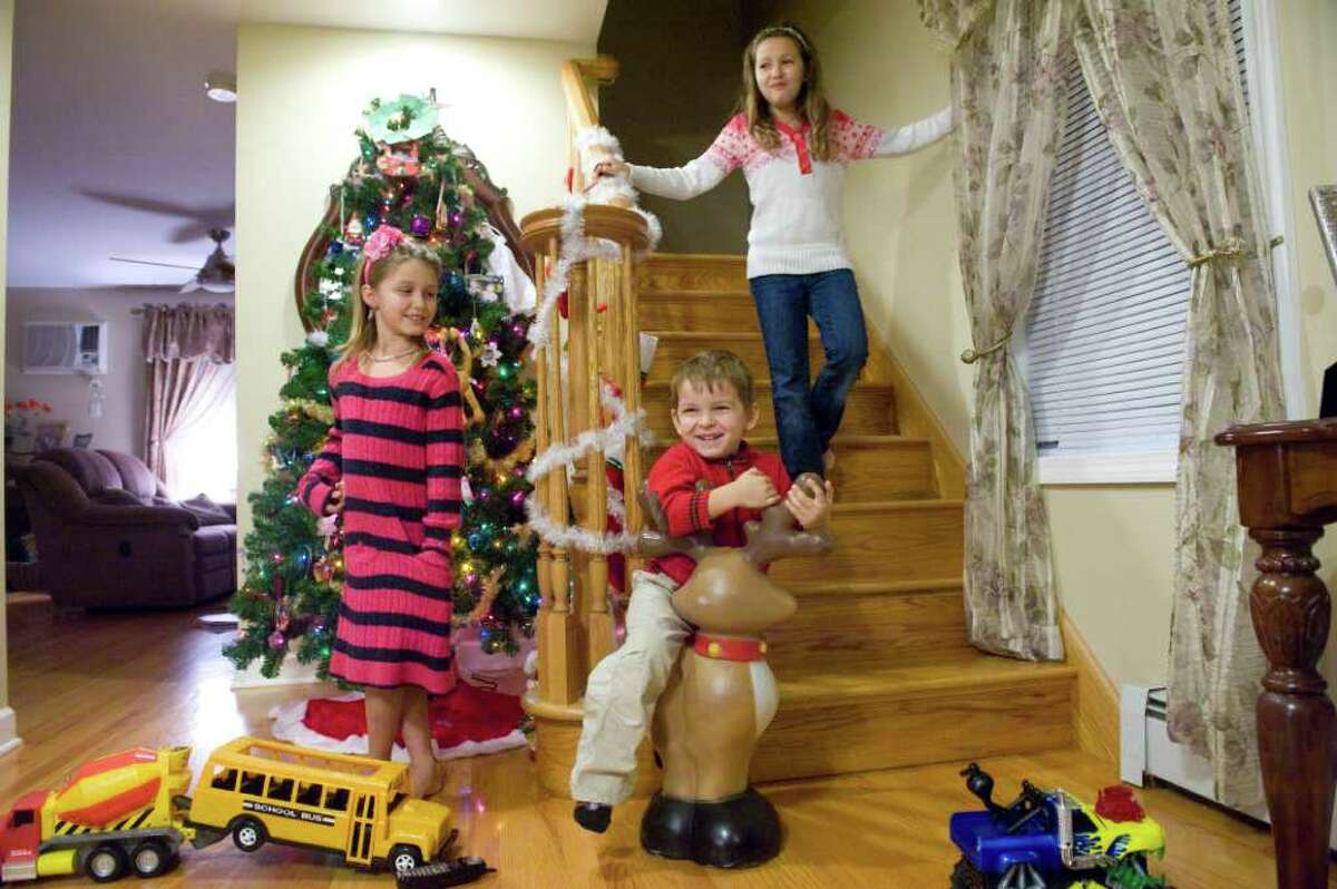 Vanessa, 7, Justin, 3, and Paulina Romano, 9, discuss their call from Santa Claus at their family home in Stamford, Conn. Tuesday evening December 14, 2010. Stamford Recreation Services sponsored the program to connect local children with Santa.
