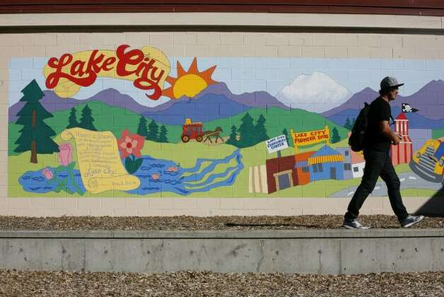 Mike, who participated in the painting of a mural as a Community Court defendant, walks past the completed project at Albert Davis Park in Lake City on Friday September 25, 2009. Mike, who rode a bus for 1 1/2 hours to get to the unveiling, said he took pride in the project. Photo: Joshua Trujillo/seattlepi.com
