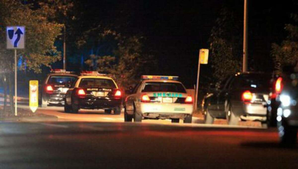 Police cars from multiple agencies speed into Lake Sammamish State Park after a shooting left at least two dead and four others wounded July 17, 2010. (Joshua Trujillo/Seattlepi.com file)