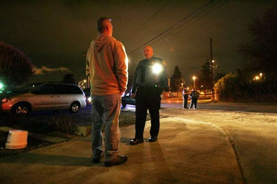 Seattle Police officer Eric Michl of the department's DUI squad administers a field sobriety test to a suspected drunken driver on Dec. 12. The driver was arrested but has not been charged. Photo: Casey McNerthney/seattlepi.com