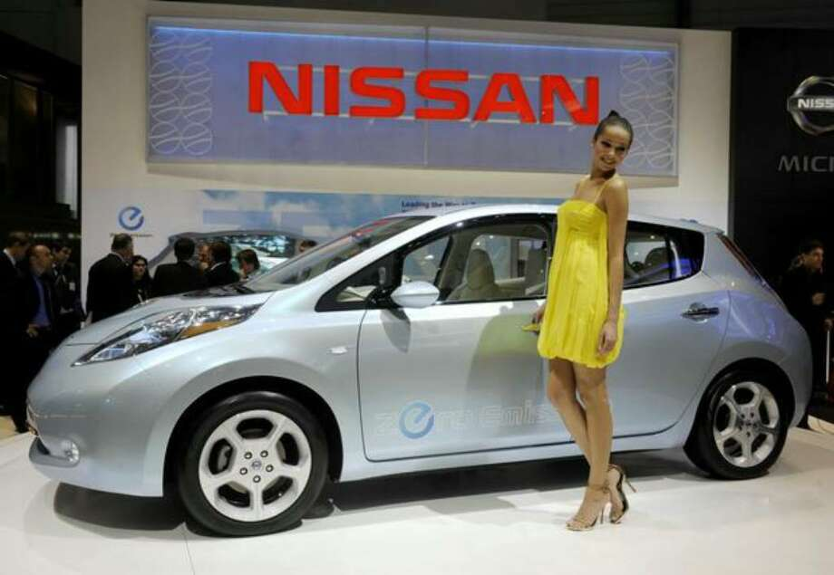 "A model poses beside the new all-electric ""Leaf"" car by Japanese carmaker Nissan on March 3, 2010 during the third press day at the 80th Geneva International Motor Show at Palexpo in Geneva, Switzerland. (Photo by Philippe Desmazes/AFP/Getty Images) Photo: / Getty Images"