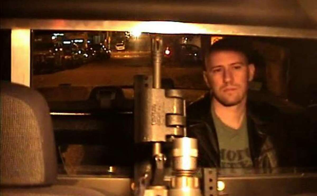 Eric Rachner sits in the back of a police car the night he was arrested for obstructing an officer. This image is taken from video footage recorded by a camera inside the vehicle -- footage that Seattle police long maintained had been erased.