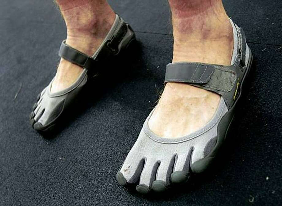 Vibram's FiveFingers shoes force runners to get up on the balls of their feet in a natural gait, adherents say. (Brant Ward / San Francisco Chronicle) Photo: / San Francisco Chronicle