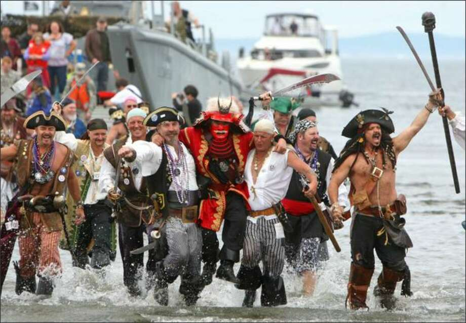 The rowdy Seafair Pirates storm Alki Beach in West Seattle to mark the beginning of Seafair in 2008. Photo: / P-I File