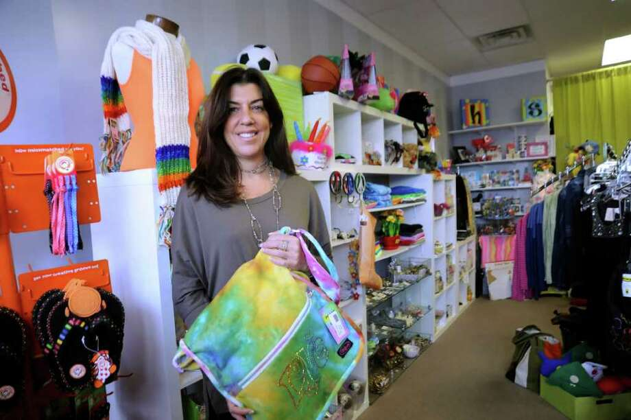 Barbara Reinken, owner of Stuf, in her store, in Byram, on Tuesday, Dec. 7. 2010. Photo: Helen Neafsey / Greenwich Time