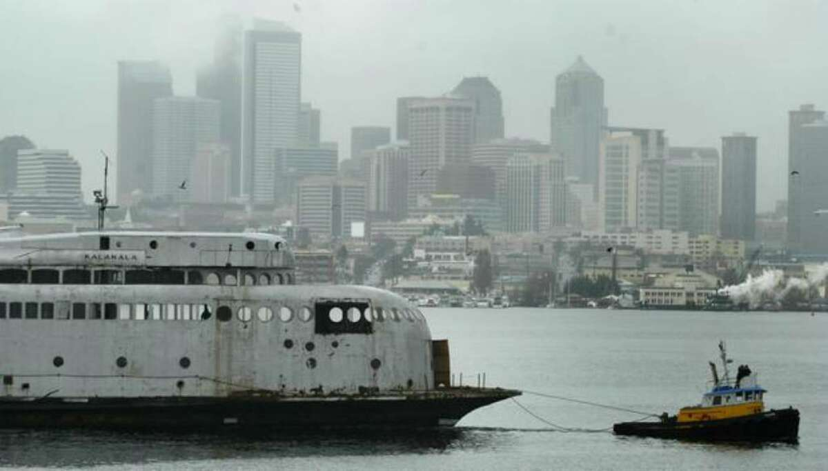 The 1930s-era art deco ferry Kalakala sets sail from Seattle's Lake Union for a trip to Neah Bay in this 2004 file photo. The vessel later moved to Tacoma, where it is berthed today.