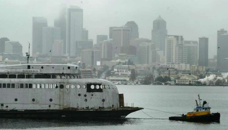 The 1930s-era art deco ferry Kalakala sets sail from Seattle's Lake Union for a trip to Neah Bay in this 2004 file photo. The vessel later moved to Tacoma, where it is berthed today. Photo: Joshua Trujillo/seattlepi.com