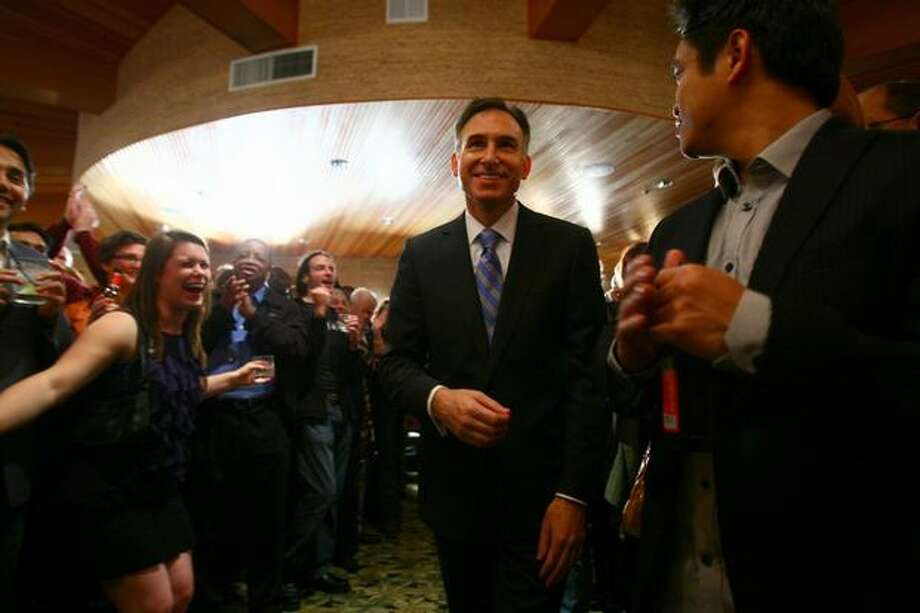 Dow Constantine walks to the podium to speak to his supporters after early returns show him defeating Susan Hutchison for King County Executive at the Edgewater Hotel in Seattle. Photo: Thom Weinstein/seattlepi.com