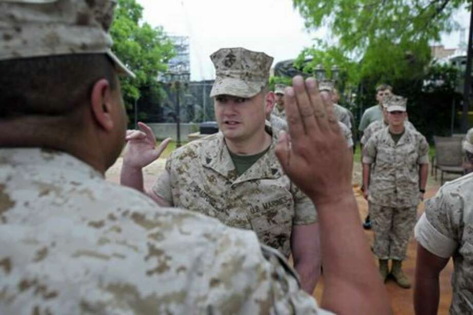 Marine Cpl. Matthew Bradford is sworn in by Lt. Col. David Barnes. Bradford lost his eyesight and both legs after a roadside bomb exploded under him in Iraq's Al Anbar province in 2007. Photo: Tom Reel/San Antonio Express-News