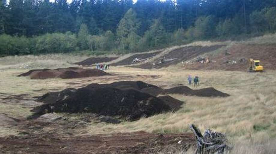 A five-acre pit on Vashon Island, left behind when workers dug out soil to cover a nearby landfill, is the site of a landscape reclamation project. (Photo courtesy David Kimmett, King County Dept. of Natural Resources and Parks) Photo: /
