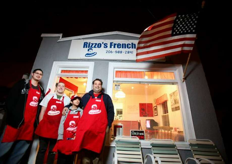 From left, Anthony Rizzo, Nathan Grier, Sonny Rizzo and Frank Rizzo stand in front of their business, Rizzo's French Dip, on 15th Avenue Northwest in Seattle. Photo: Joshua Trujillo/seattlepi.com