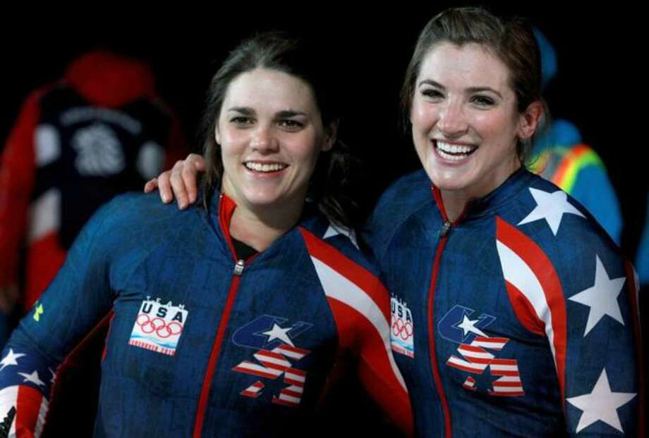 Bree Schaaf (right) and Emily Azevedo of the USA 3 bobsled celebrate their fourth and final run Wednesday at the Whistler Sliding Centre in Whistler, B.C. (Photo by Alexander Hassenstein/Bongarts/Getty Images) Photo: / Getty Images
