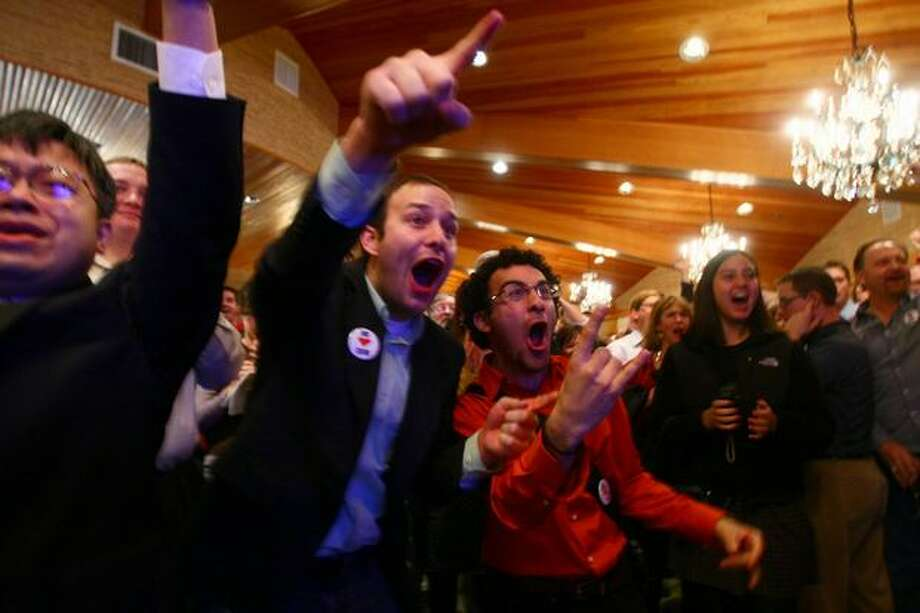 Sam Christensen and Faraz Zarghami react to R-71's lead in early returns at a party at the Edgewater Hotel in Seattle. Photo: Thom Weinstein/seattlepi.com