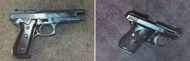 Police recovered these two pistols from the scene of Thursday's shootings: a Taurus 9mm, left, and a Beretta 25 caliber. Both guns had been fired. Photo: Seattlepi.com Staff