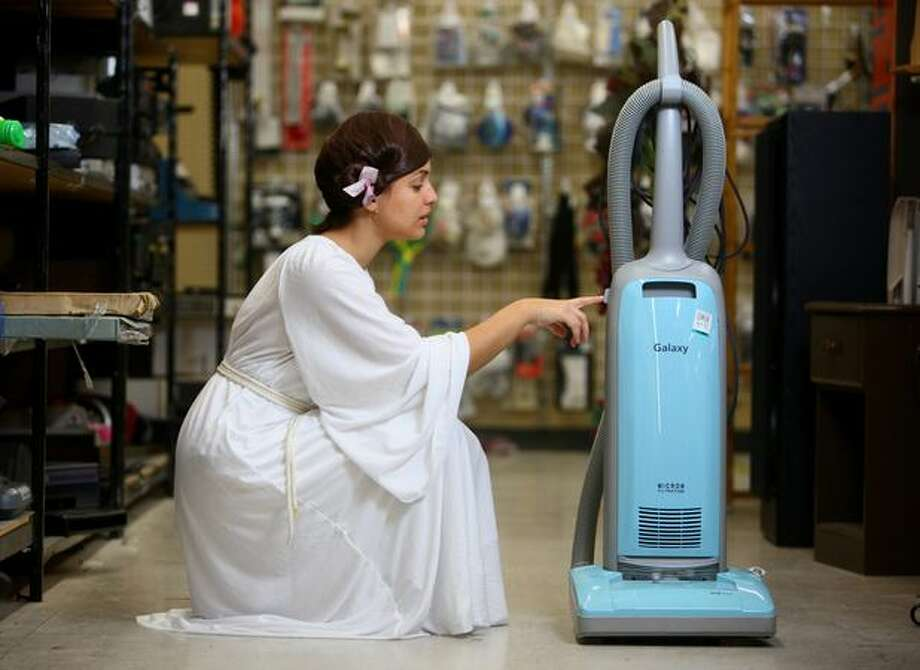 """Princess Leia"" -- Dress, $14.99; rope belt, 99 cents; shoes, $4.99; wig, $5.99; vacuum droid accessory, $24.99. Photographed at Value Village in Seattle. Photo: Joshua Trujillo/seattlepi.com"