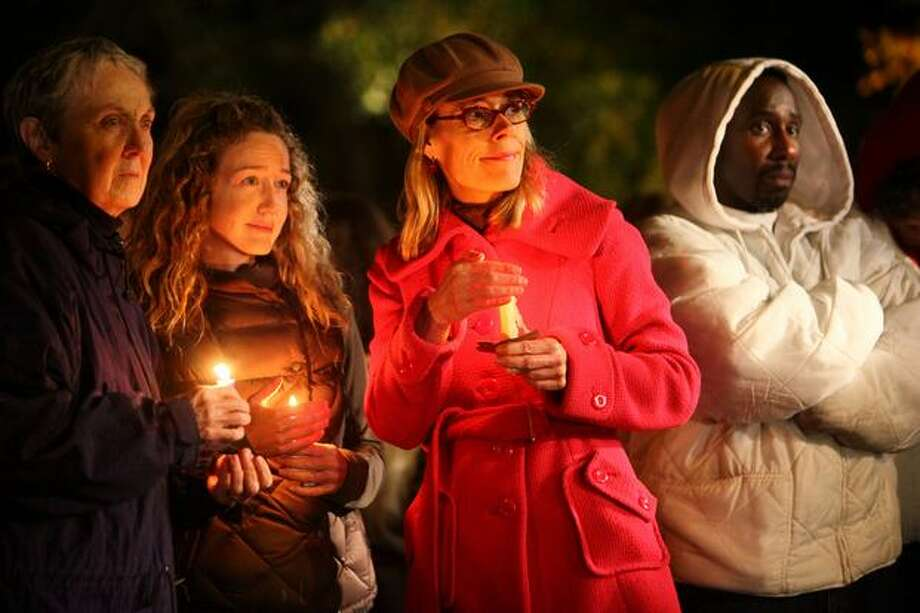 Neighborhood residents, from left, Patricia Sandilands, Anna Sandilands, Patricia Thompson and Ray Watson gather during the vigil. Photo: Joshua Trujillo/seattlepi.com