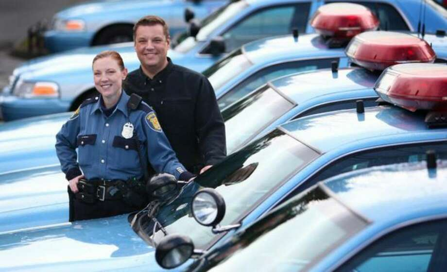 Married Seattle Police Officers Chris Myers and Suzie Parton are shown at the North Precinct in Seattle on Friday, Feb. 12, 2010. She is on the crisis intervention team and he is a West Precinct patrol officer. Photo: Joshua Trujillo/seattlepi.com