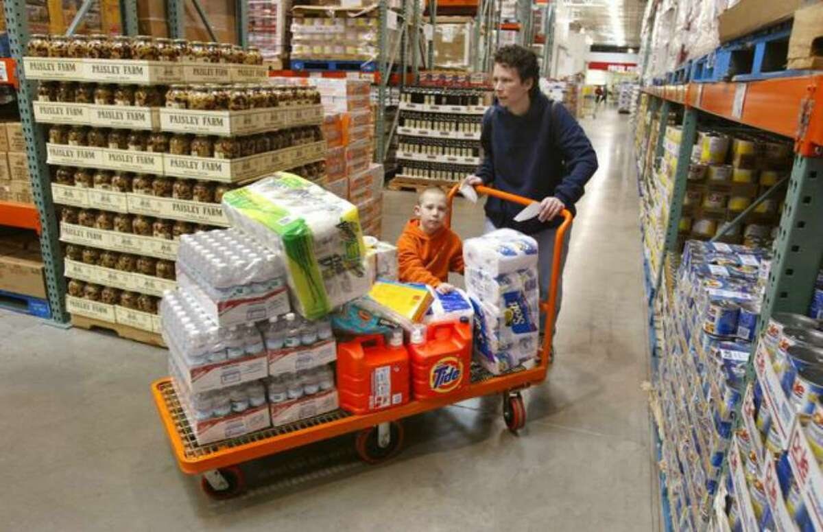 A Chicago shopper and her son push a large grocery cart through a Costco store in Niles, Ill., in this file photo.