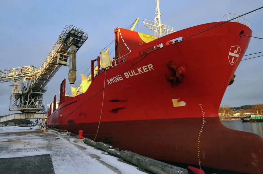 A grain elevator is manuevered into position over a ship's hold as grain is loaded onto a transport ship at the Port in Albany, NY  on Tuesday December 14, 2010.      (Philip Kamrass / Times Union ) Photo: Philip Kamrass